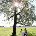Newlyweds under a tree at Willowbank