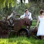 Wedding photo on an old rusty tractor